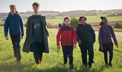 "Louis Ashbourne Serkis (center) stars in ""The Kid Who Would Be King""."