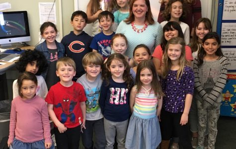 Erin Moulton, the next principal at Hosmer Elementary School in Watertown, poses with Husky Howl reporters after an interview in the newsroom Tuesday, April 9, 2019.